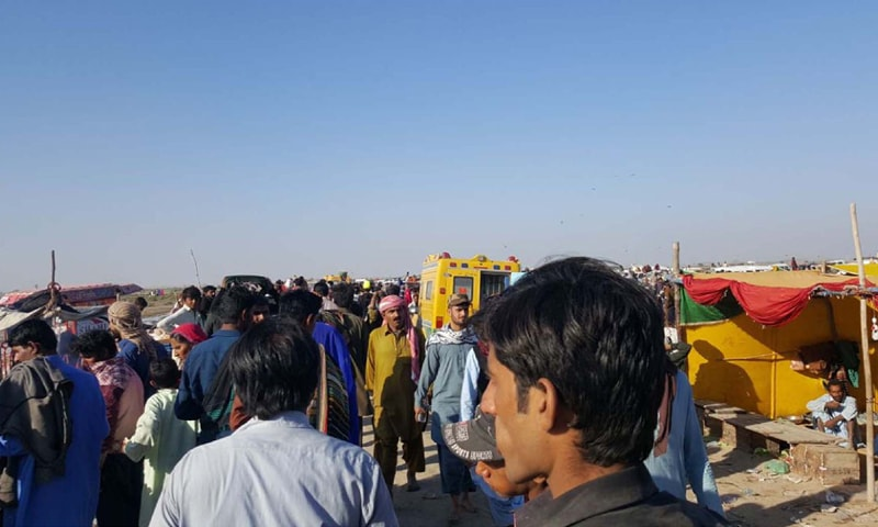 Thatta: Local people gather at the venue where a boat capsized near here on Thursday.—PPI