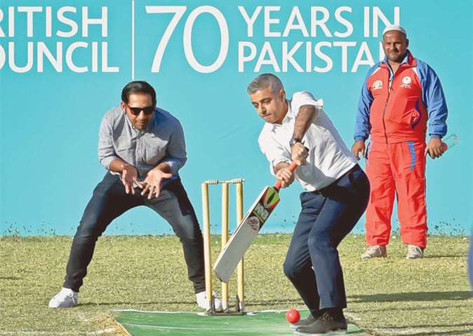 SADIQ Khan keeps his eye on the ball during a cricket match at the British Deputy High Commission on Friday while Pakistan skipper Sarfraz Ahmed stands in as keeper.—Fahim Siddiqi / White Star