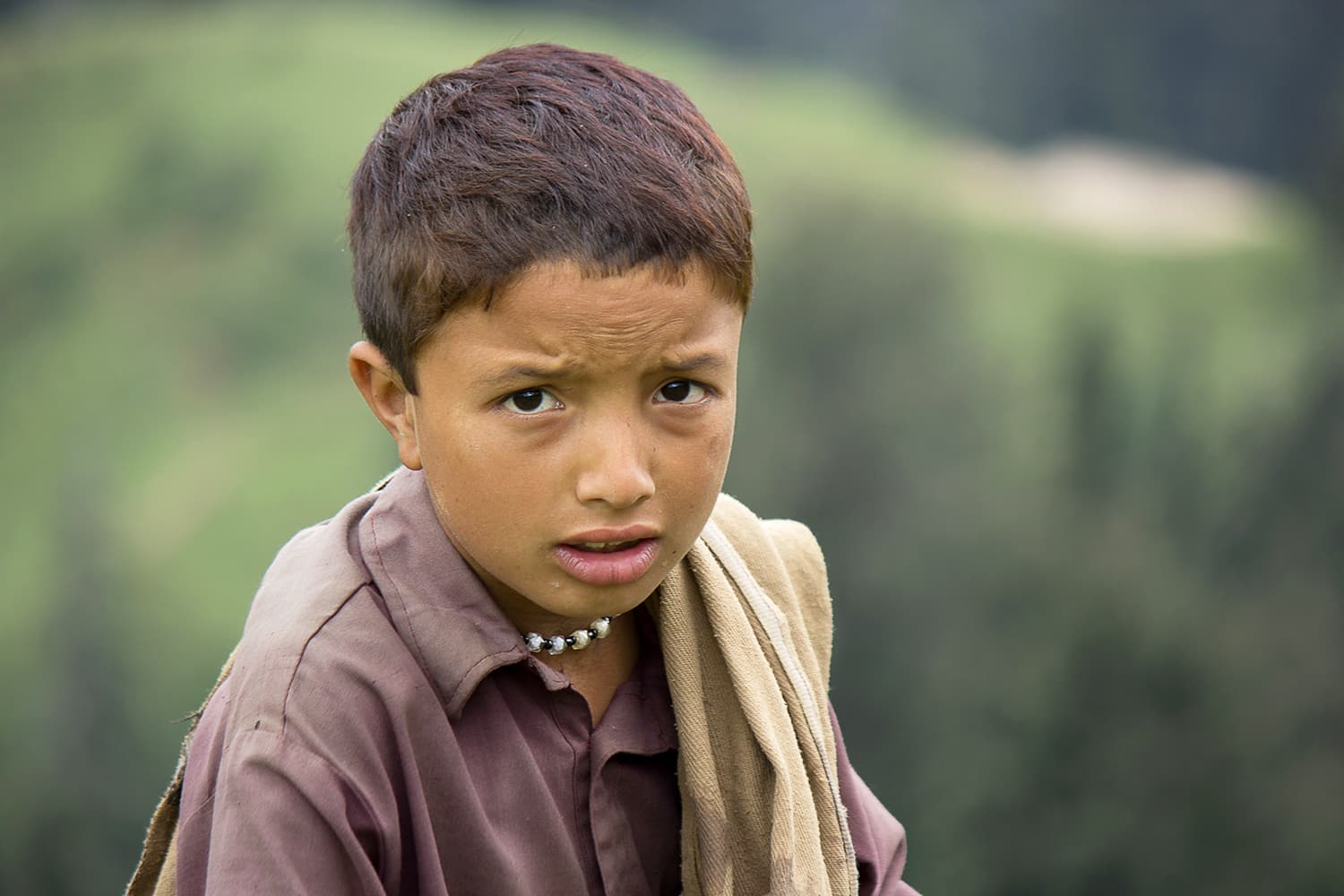A curious, friendly boy at Araam Gali.