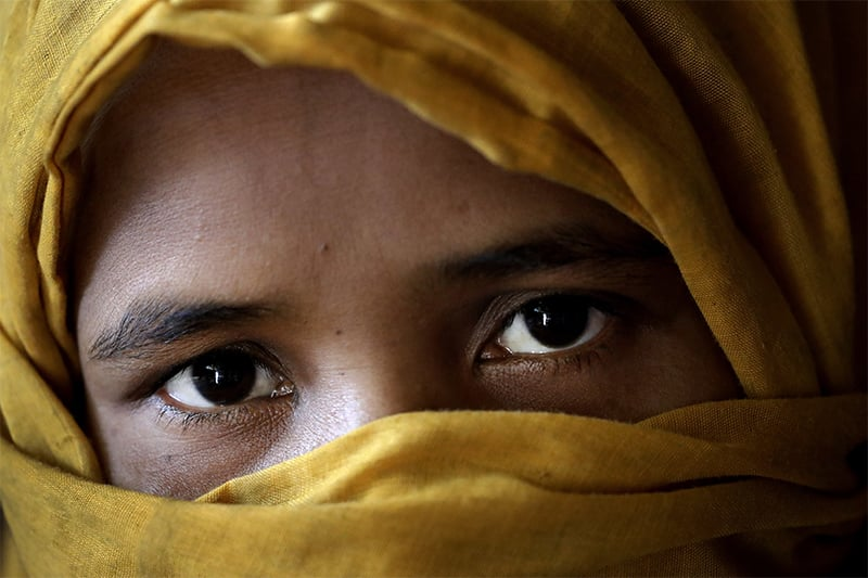 K, 30, mother of six whose 3-year-old daughter was killed, who says she was raped by members of Myanmar's armed forces in late August, is photographed in her tent in Kutupalong refugee camp in Bangladesh. ─ AP