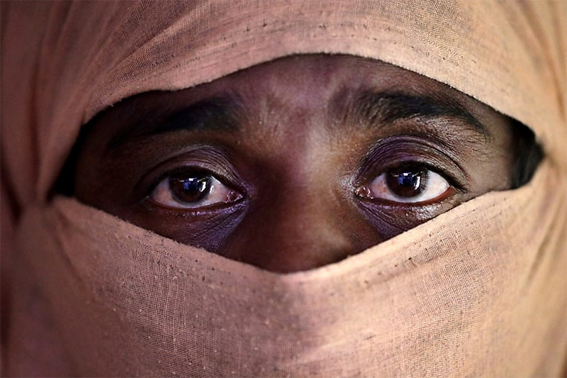 A, 35, mother of four, who says she was raped by members of Myanmar's armed forces in late August, is photographed in her friend's tent in Kutupalong refugee camp in Bangladesh. ─ AP