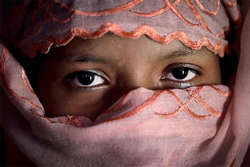 R, 13, who says she was raped by members of Myanmar's armed forces in late August, is photographed in her family's tent in Kutupalong refugee camp in Bangladesh. ─ AP