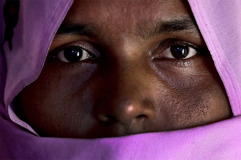 H, 30, mother of six; three children killed, who says she was raped by members of Myanmar's armed forces in late August, is photographed in her friend's tent in Kutupalong refugee camp in Bangladesh. ─ AP
