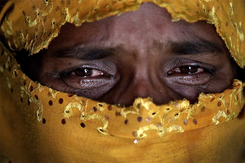 K, 25, cries as she recounts being gang raped by members of Myanmar's armed forces during an interview with AP in her tent in Kutupalong refugee camp in Bangladesh. ─ AP