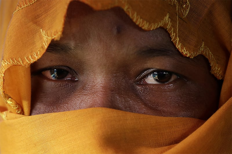 R, 28, mother of six, who says she was raped by members of Myanmar's armed forces in late August, is photographed in her tent in Kutupalong refugee camp in Bangladesh. ─ AP