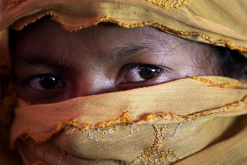 S, 22, mother of one, who says she was raped by members of Myanmar's armed forces in late August, is photographed in her tent in Gundum refugee camp in Bangladesh. ─ AP