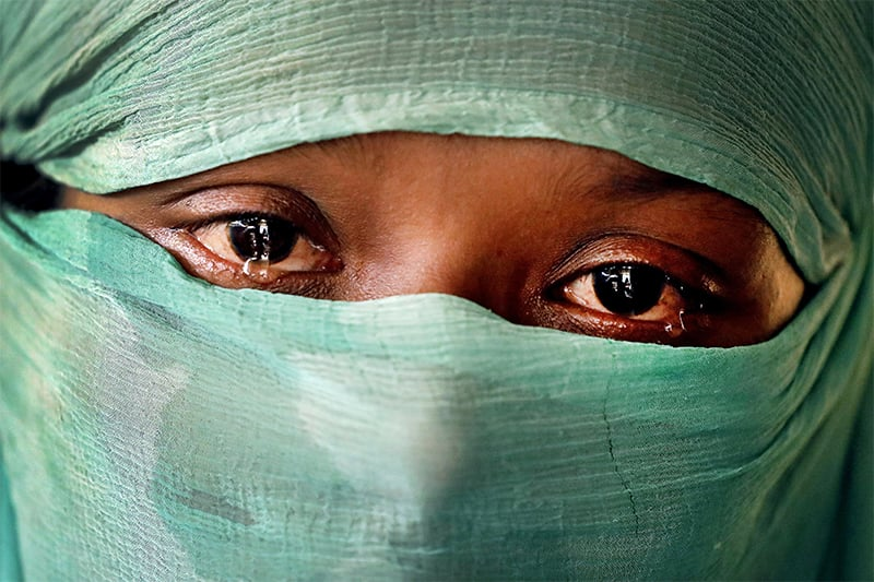 F, 22, who says she was raped by members of Myanmar's armed forces in June and again in September, cries as she speaks to AP in her tent in Kutupalong refugee camp in Bangladesh. ─ AP