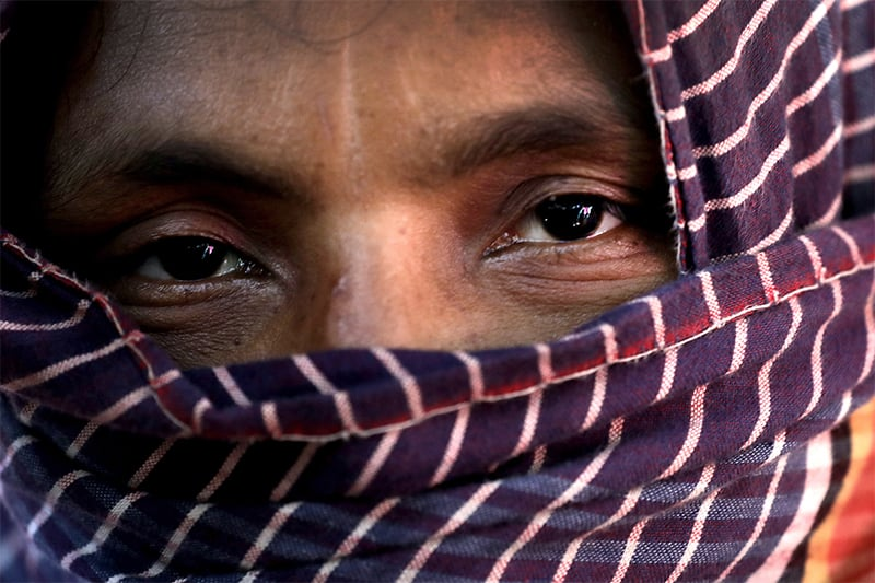 D, 30, missing two of her four sons, who says she was raped by members of Myanmar's armed forces in late August, is photographed in a friend's tent in Kutupalong refugee camp in Bangladesh. ─ AP
