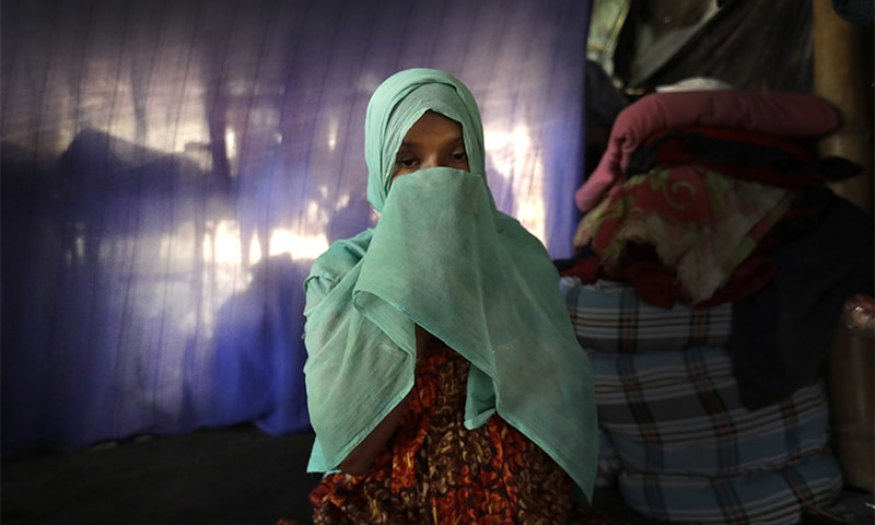 F, 22, pregnant, prays in her tent in Kutupalong refugee camp in Bangladesh. ─ AP
