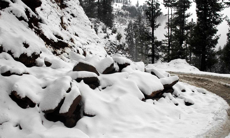 Heavy snow covers rocks in Shangla.— Umar Bacha