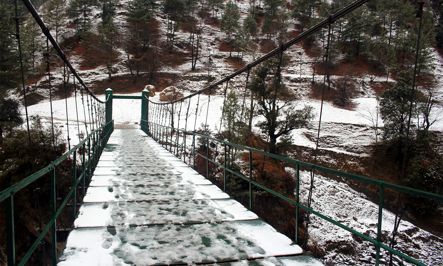 A view of a bridge covered with snow in Shangla.— Umar Bacha