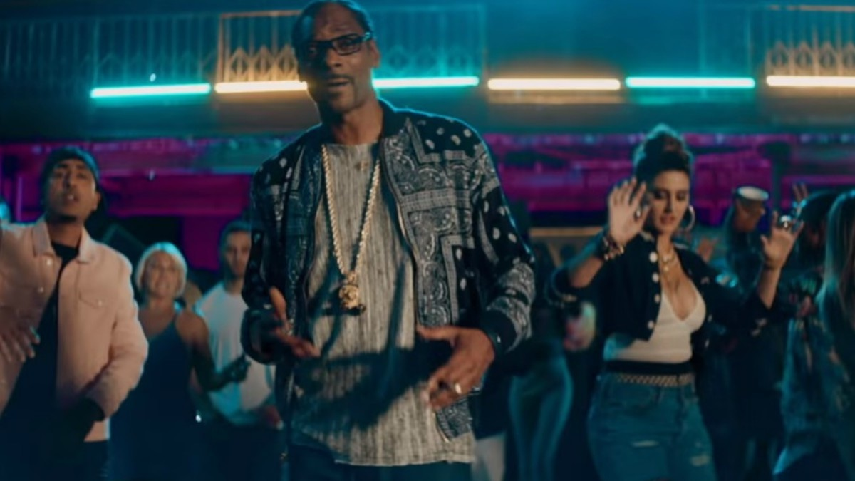 Snoop Dogg and Nargis Fakhri in a still from their new video