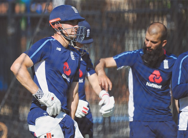 PERTH: England opener Alastair Cook (L) waits to bat during a net practice session on Wednesday.—AFP