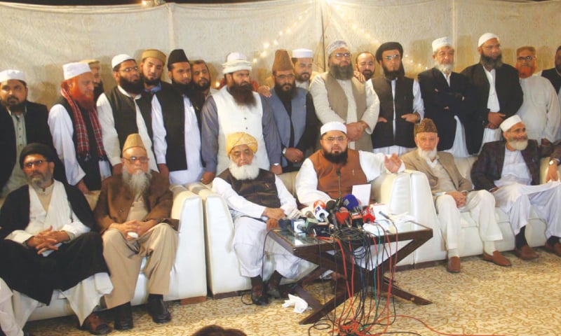 JAMAIT Ulema-i-Pakistan chief Shah Ovais Noorani addressing a press conference at Bait-ul-Rizwan in Clifton after the decision to revive the Muttahida Majlis-i-Amal. Other leaders of the five-party alliance are also seen.—Online