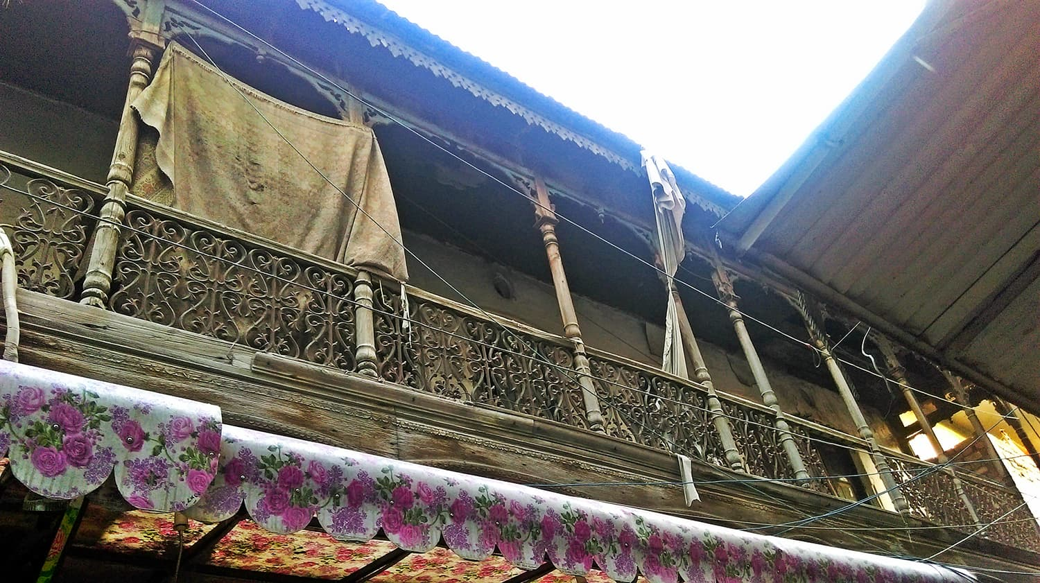 A colonial style wooden gallery of Qasai Gali.