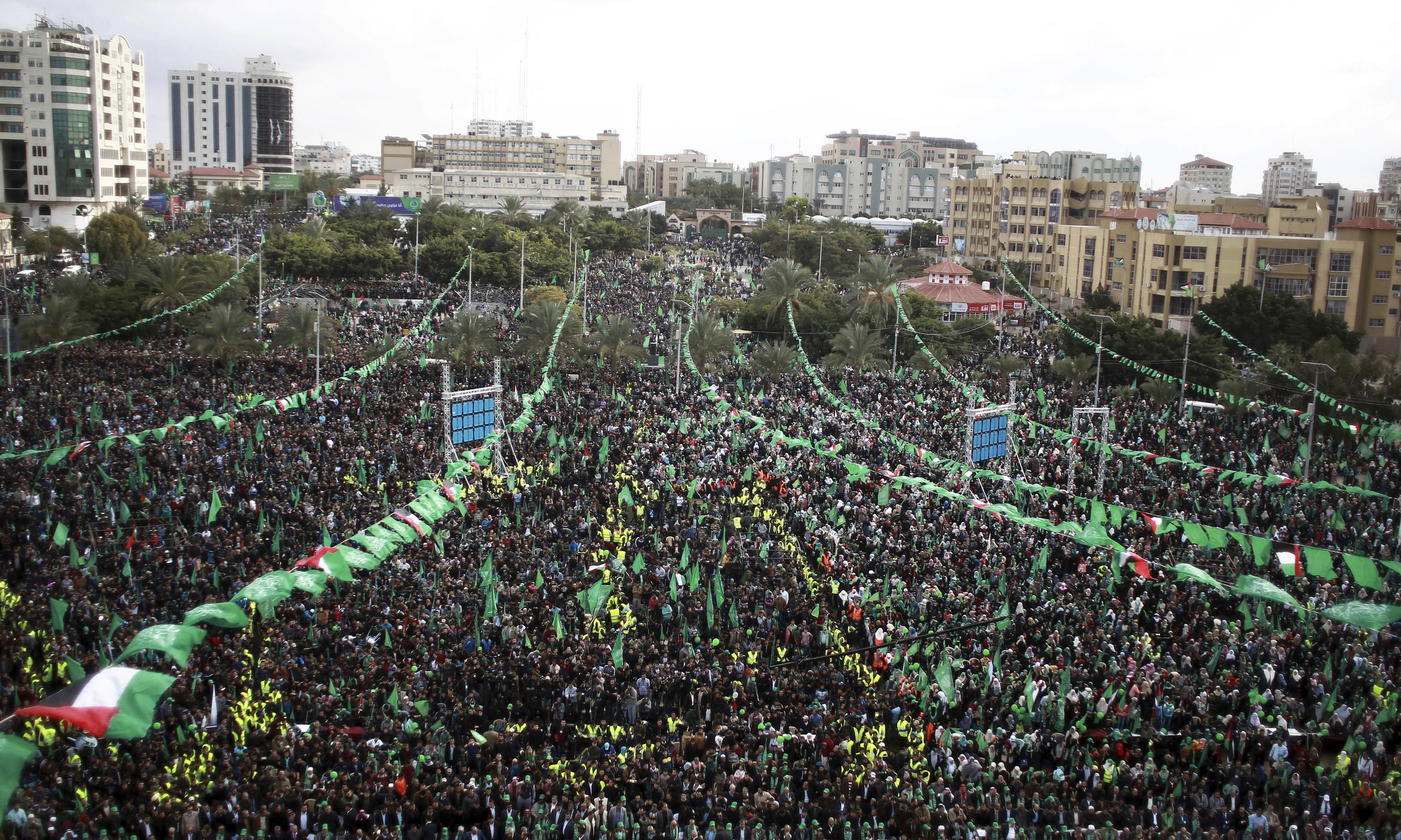 Supporters attend a Rally marking the 30th anniversary of Hamas movement, in Gaza City. —AP