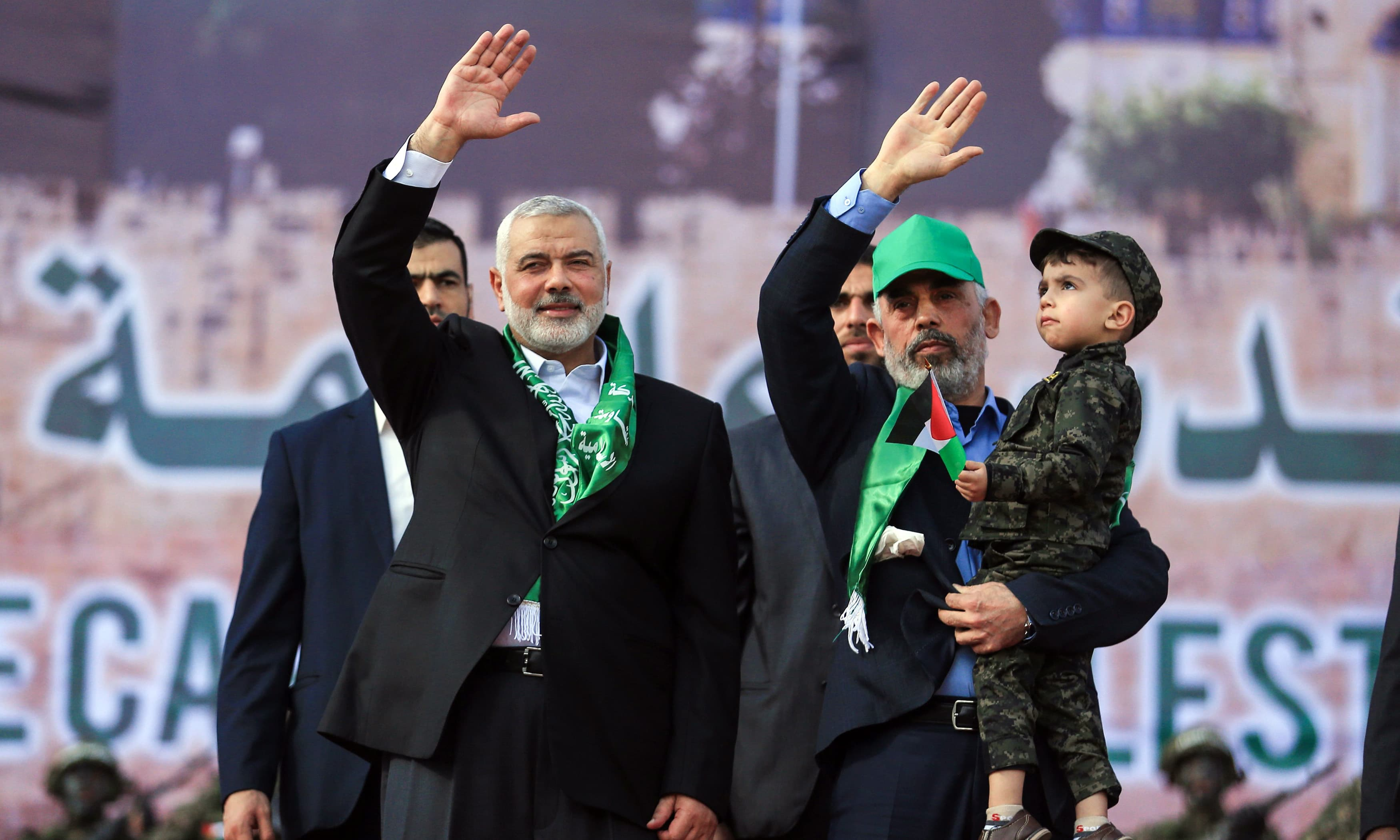 Hamas leader Ismail Haniya waves during a rally marking the 30th of the founding of the movement. —AFP