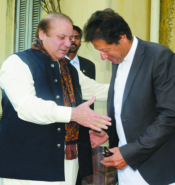 ISLAMABAD: PTI Chairman Imran Khan warmly receives Prime Minster Nawaz Sharif at his residence Banigala here on March 12, 2014. White Star —