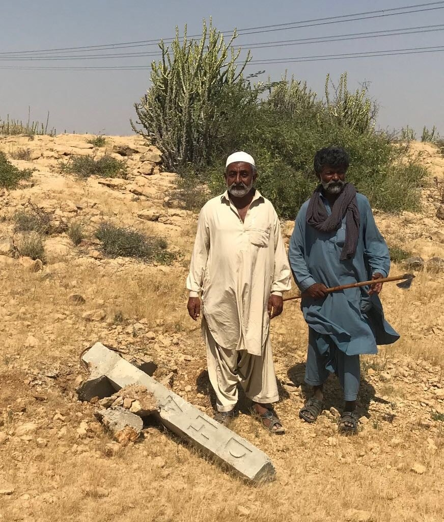 Ibrahim Kachelo standing alongside one of the DHA markers that he knocked down. — White Star