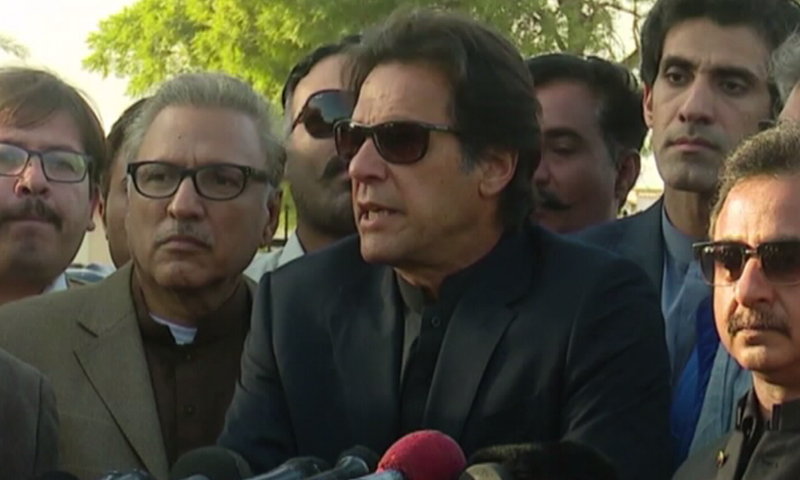 PTI chief Imran Khan speaks to the media in Karachi. —DawnNews