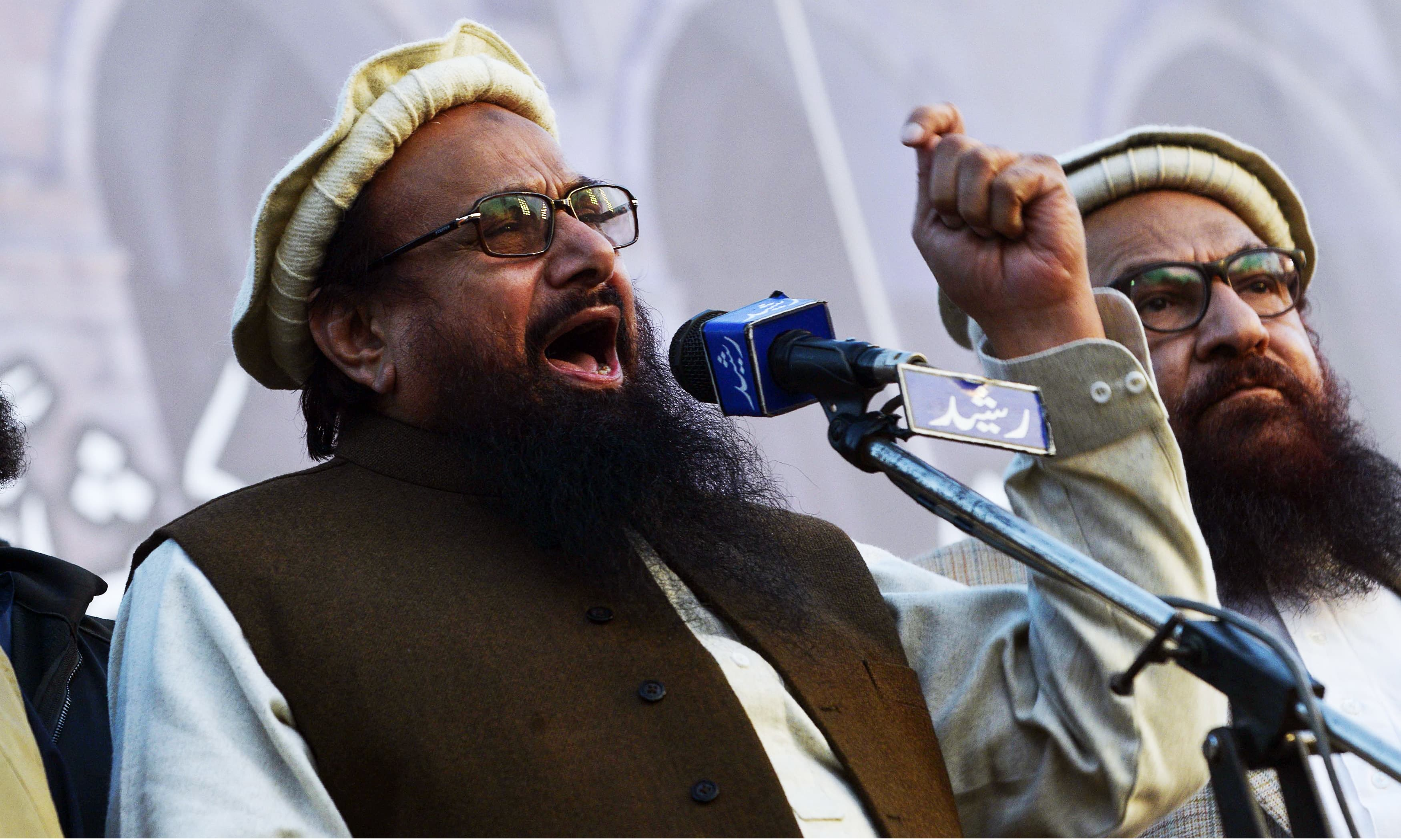JuD chief Hafiz Saeed addresses an anti-US rally in Lahore. —AFP
