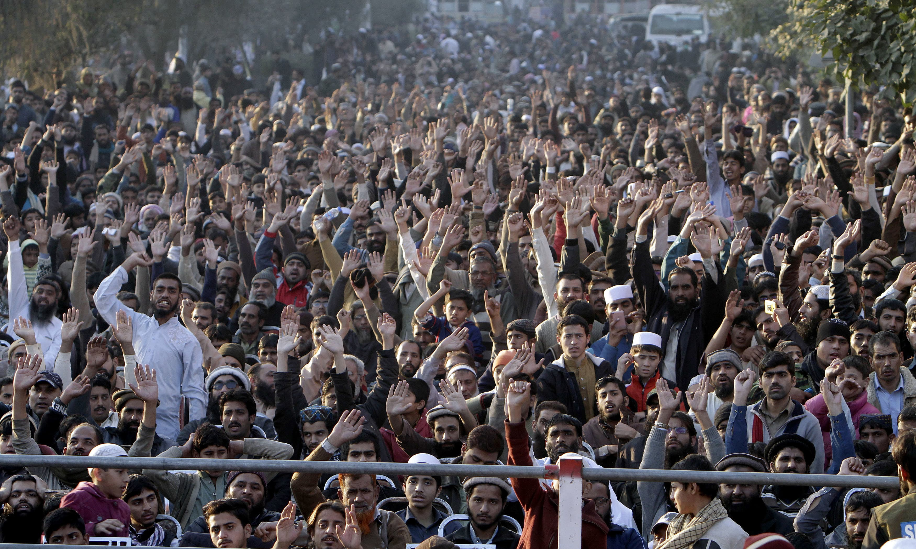 Supporter of religious parties chant slogans during a rally against the US in Lahore. —AP