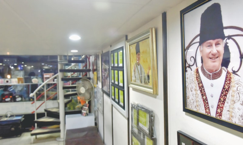 PORTRAITS of the Aga Khan are displayed at a Clifton photography shop.—White Star