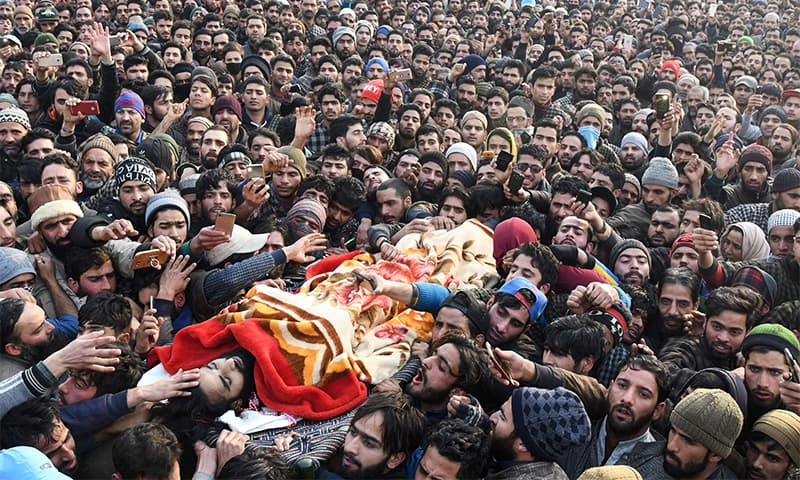 Kashmiri villagers surround the body of suspected militant Tanveer Ahmed during his funeral at Batmurran Kellar village in Shopian on Tuesday.— AFP
