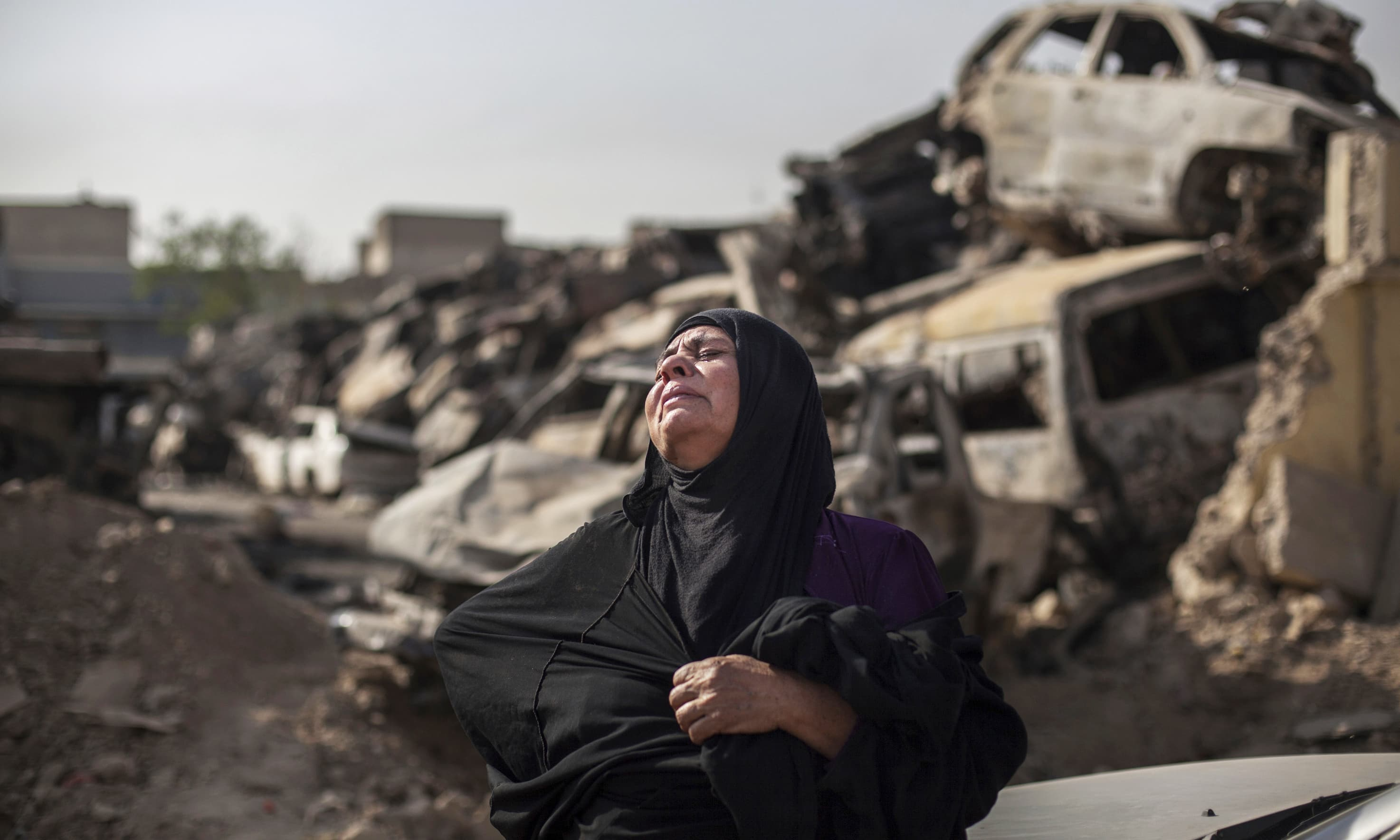 Fatima Ahmed Aswad cries as the body of her 15-year-old daughter Sana is exhumed in Mosul for forensic investigation in order to receive a death certificate. —AP