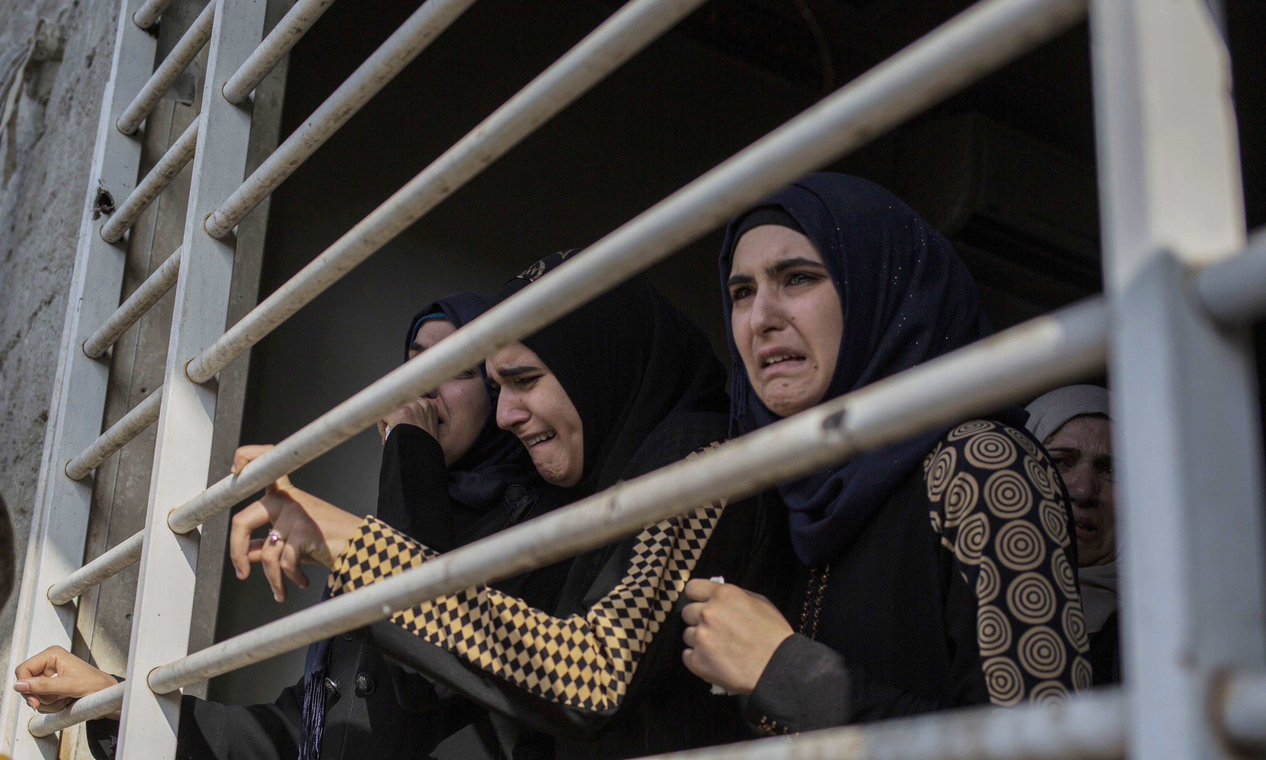 A family disinters the body of a loved one from their garden in Mosul for forensic investigation, as required for a death certificate for those killed during the final battle to oust the militant IS. —AP