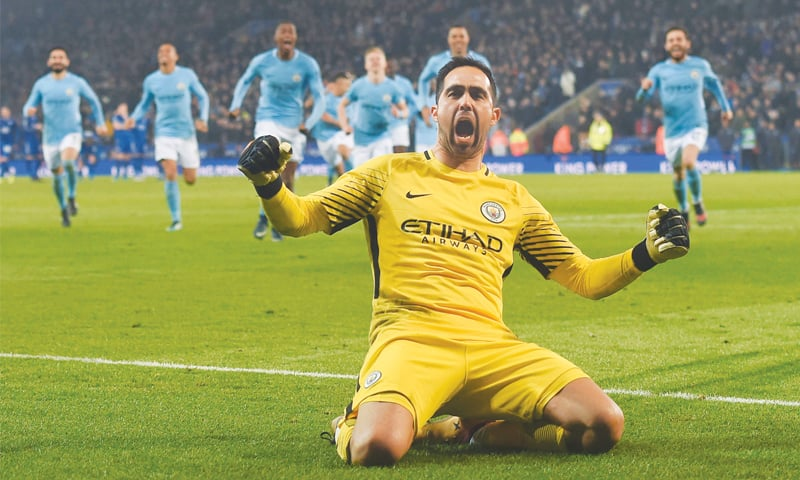 LEICESTER: Manchester City goalkeeper Claudio Bravo celebrates after saving the final Leicester City penalty to win the shootout in their League Cup quarter-final at the King Power Stadium.—AFP