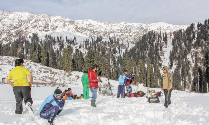 Tourists take pictures in Gabina Jabba area of Swat. — Dawn