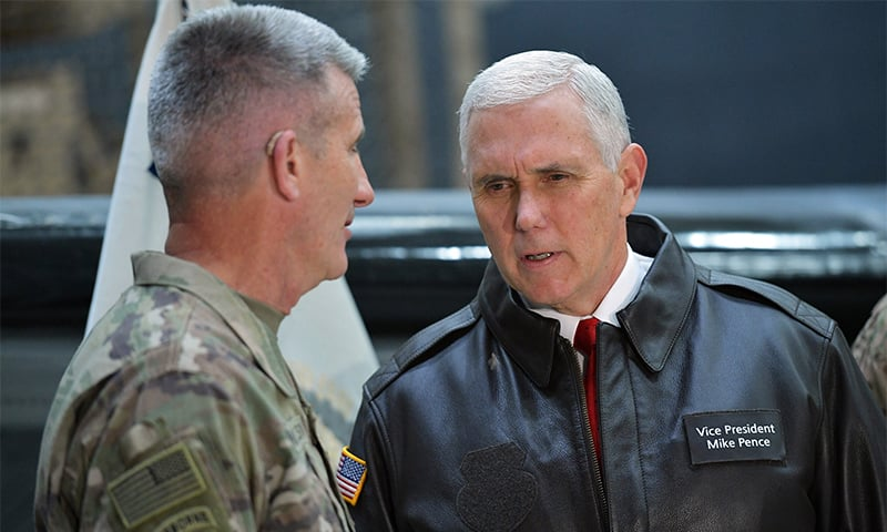 US Vice President Mike Pence speaks to Gen. Nick Nicholson, commander of US forces in Afghanistan, in a hangar at Bagram Air Base in Afghanistan. ─ AP