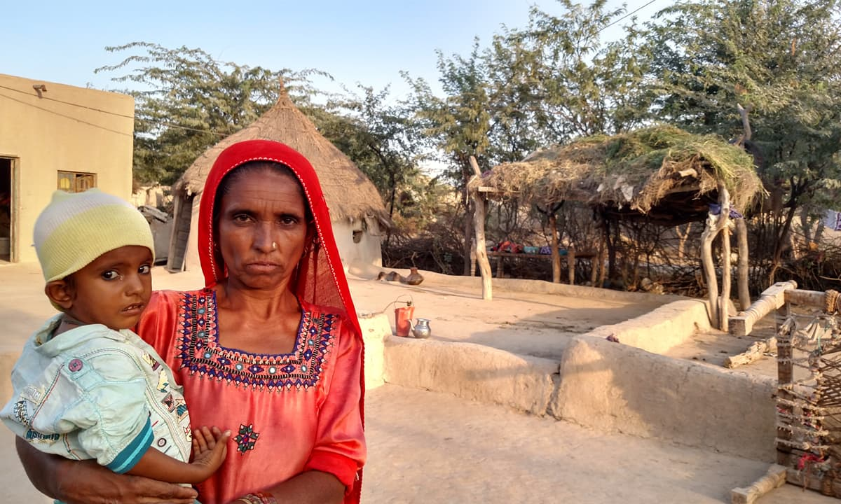 Fatima with her grandson in their home in Kharooro Charan, Umerkot | Photos by Bilal Karim Mughal