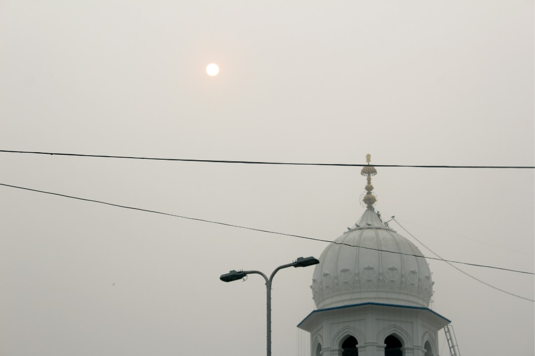 The sun sets over Nankana Sahib