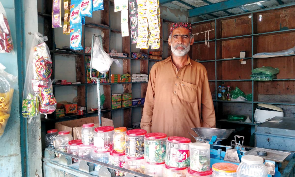 Abdul Karim Mangrio at his shop in Umerkot