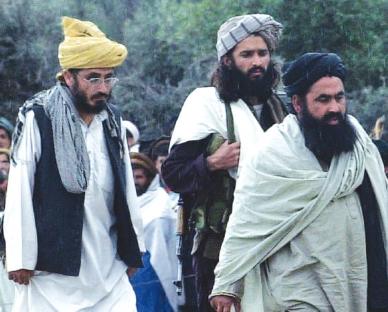 TTP chief Baitullah Mehsud (right) was immediately accused of orchestrating Benazir Bhutto's assassination