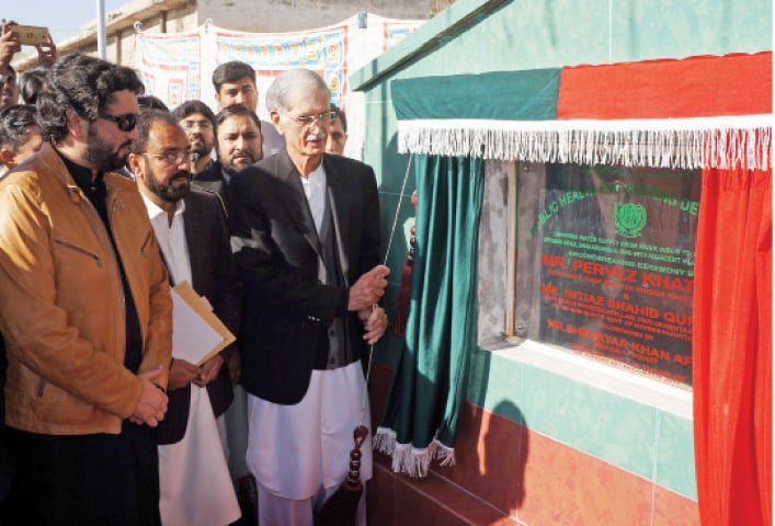 Chief Minister Pervez Khattak opens work on water supply scheme in Shakardara, Kohat, on Sunday. — Dawn