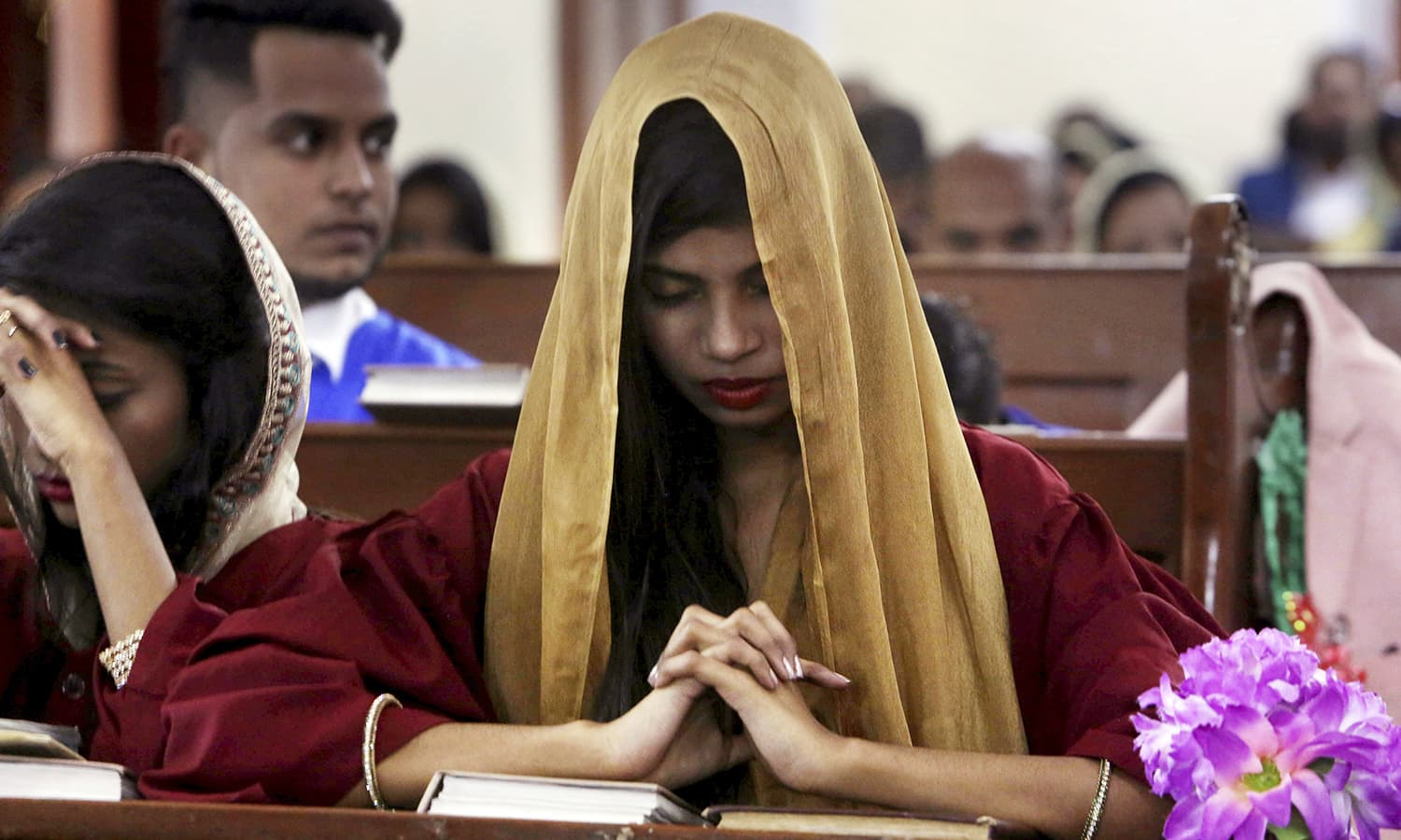 A Christian girl prays during midnight Christmas Mass at Christ church in Karachi  AP