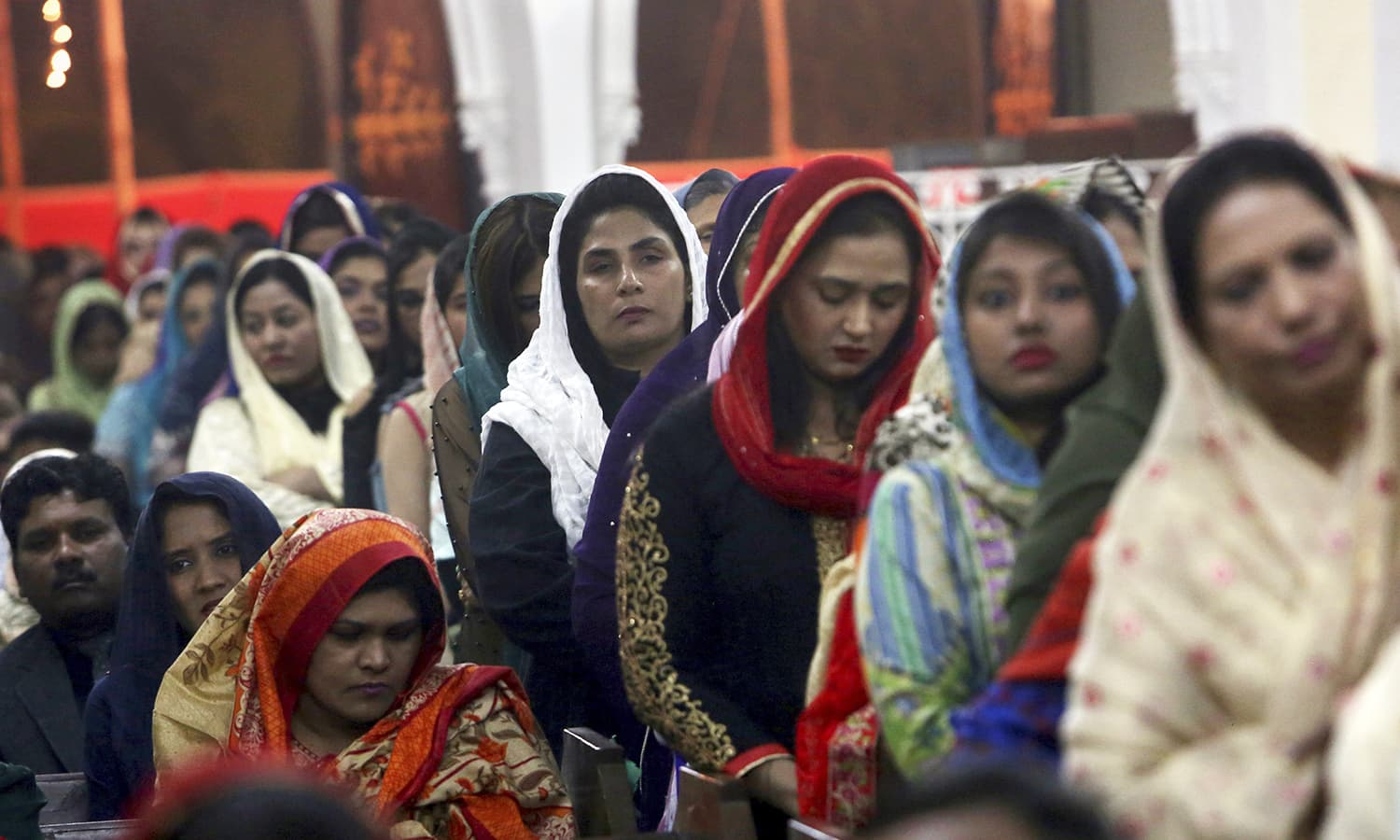 Christians attend midnight Christmas Mass at Christ church in Karachi  AP