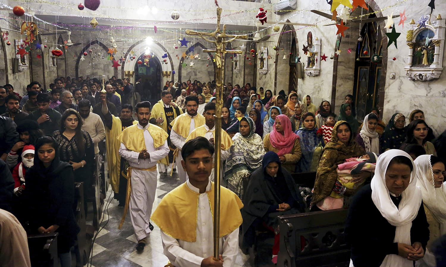 Christians attend midnight Christmas Mass at St Anthonys church in Lahore  AP