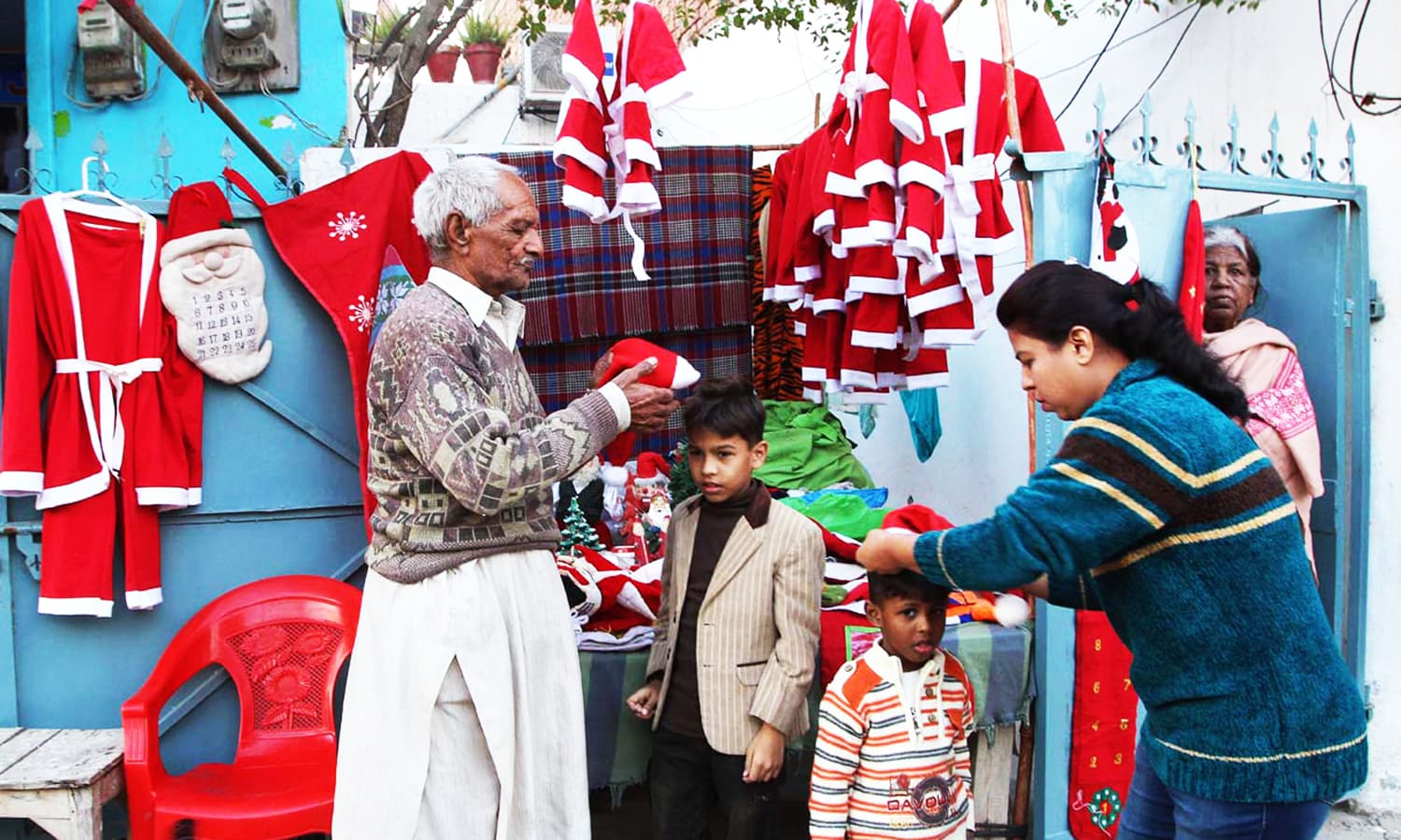 A vendor selling Santa Claus costumes to the customers at his stall  APP