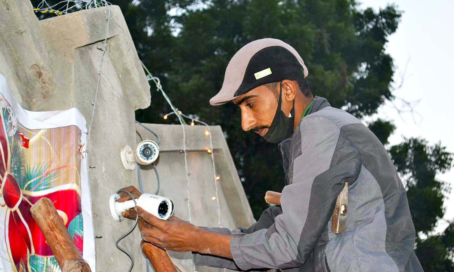 A worker installing CCTV Camera at Church Nori Gate in connection with the Christmas celebration in Sargodha  APP