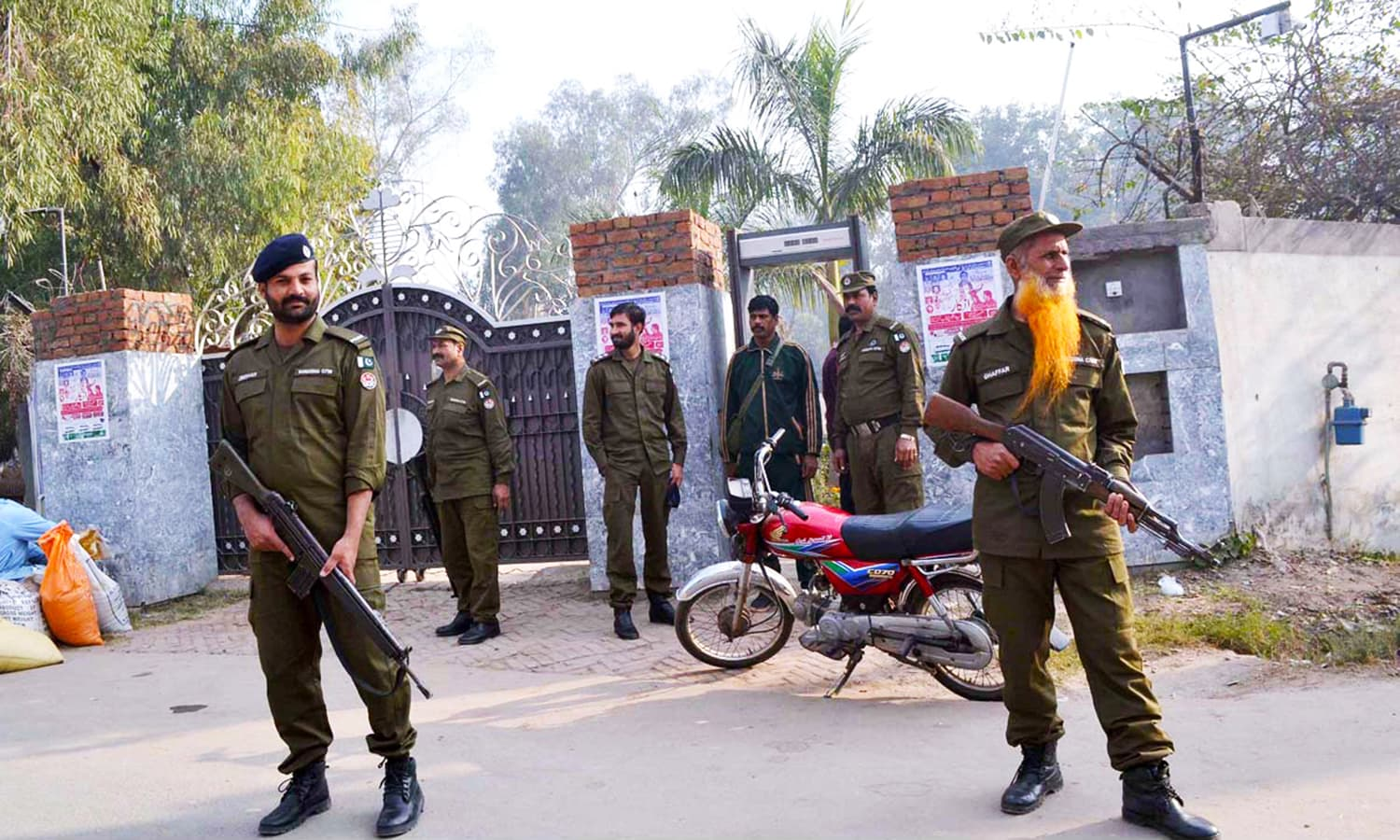 Security personnel high alert on the gate of a Church at College Road in Sargodha  APP