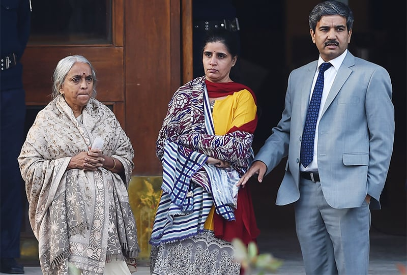The wife (2L) and mother (L) of Kulbushan Jadhav leave after meeting with Jadhav at the Foreign Ministry in Islamabad.— AFP