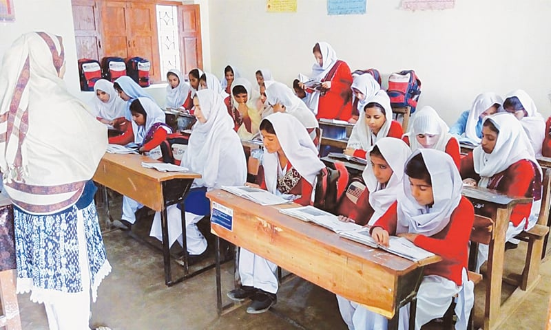 students who resumed their studies in secondary grades sit in a classroom in the government girls secondary school in Bhanoth town.—Photo by writer