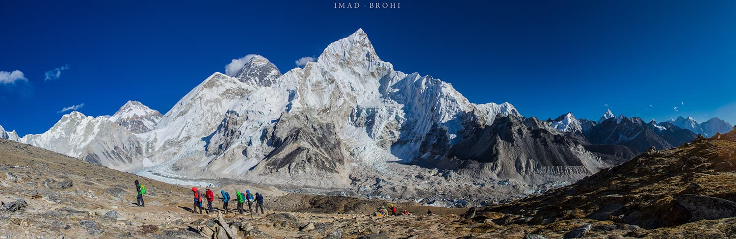 Panoramic view from Kala Pathar. Trekkers arrive in the afternoon to view Mt. Everest. Milestones left to right: Khumbutse (6,636m), Changtse (7,543m, in Tibet), Lho Laa (6,006m), Khumbu Icefall, Everest (8,848m), Nuptse (7,861m), Nuptse Icefall and Ama Dablam (6,812m).