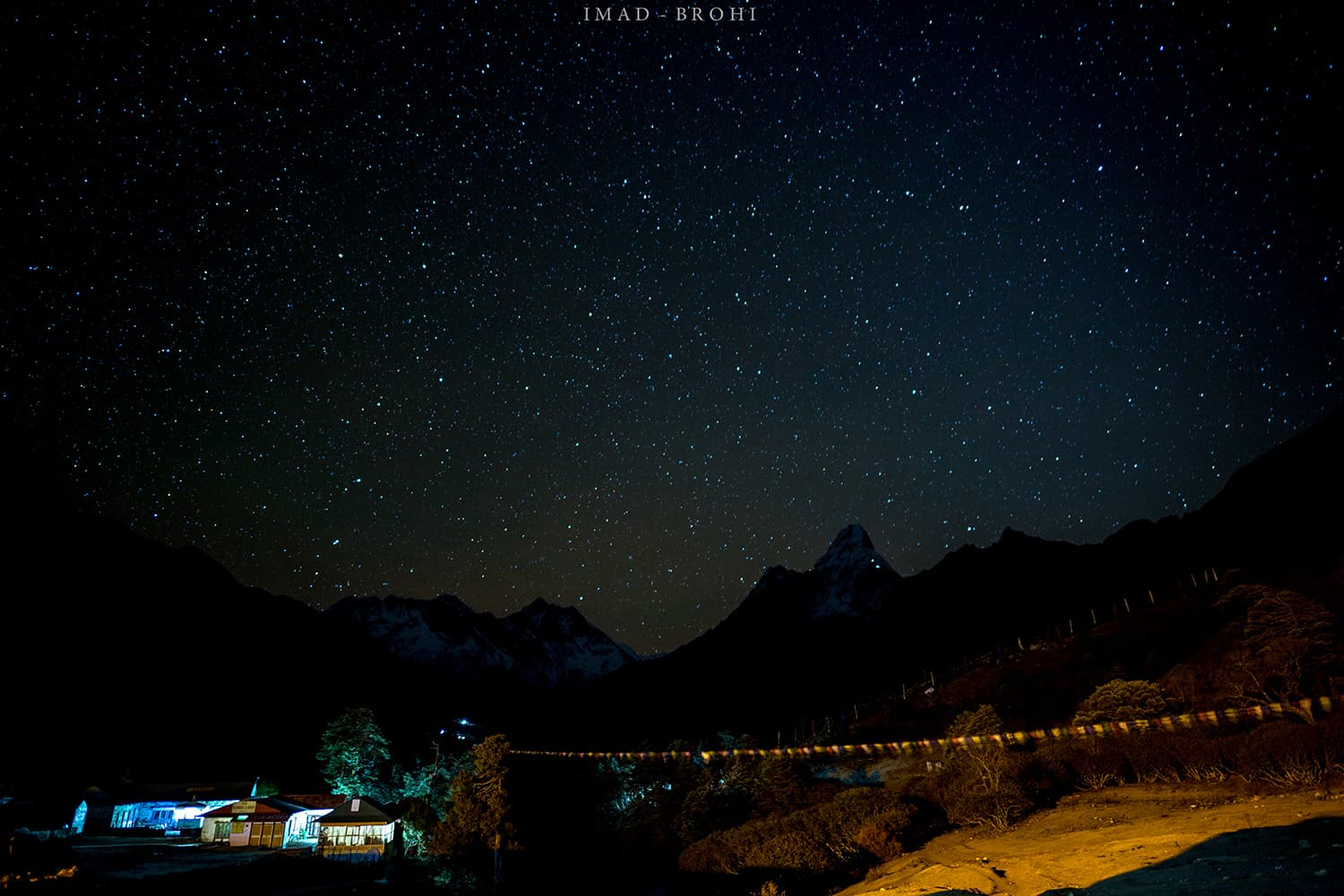 Day 5: Night falls over Tengboche. The lights on Ama Dablam are of climbers attempting to summit.
