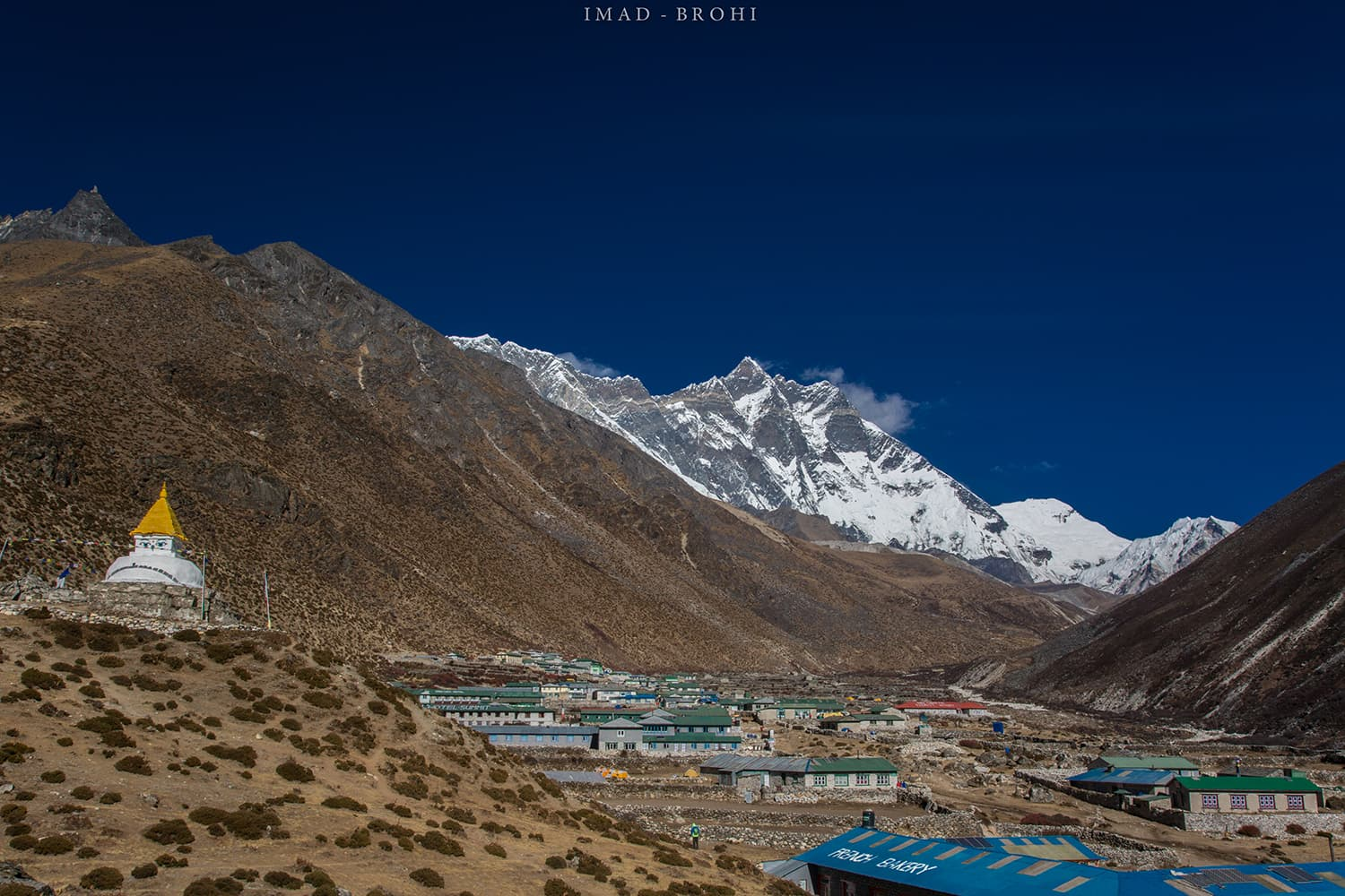 Day 6: Arrival at Dingboche. A stupa stands on guard with lodges in the community and Lhotse in the back drop.