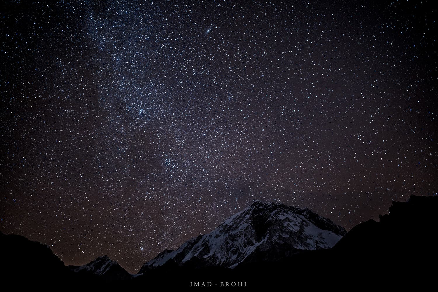 Day 8: Night falls on Lobuche Camp (4,900m). Stars and the galaxy of Andromeda light up the sky over Nuptse (7,861m). We are now too close to Nuptse which is blocking our view of Mount Everest.